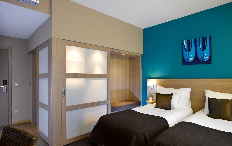 Golfexpedition-Golfreizen-België-Brussel-Waterloo-course-slaapkamer-blauw