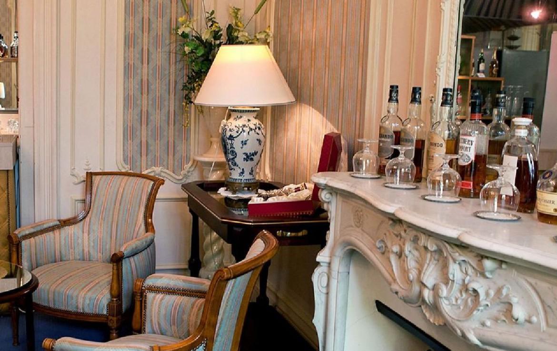 golf-expedition-golf-reizen-frankrijk-regio-champagne-grand-hotel-des-templiers-lounge-openhaard.jpg