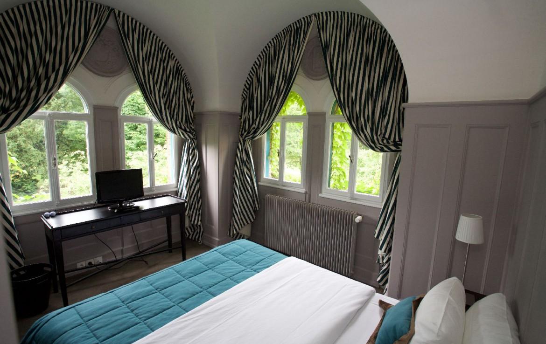 golf-expedition-golf-reizen-frankrijk-regio-elzas-le-kempferhof-moderne-slaapkamer-twee-personen-met-uitzicht-op-golfbanen.jpg