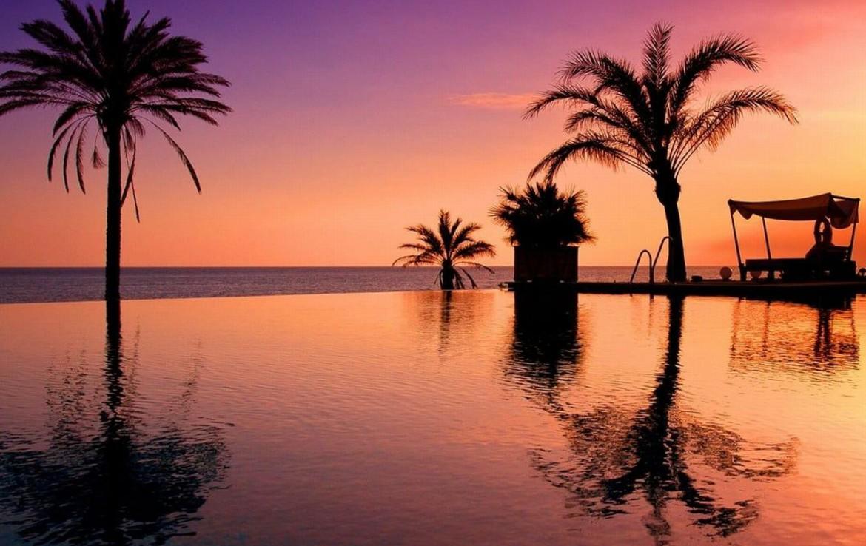 golf-expedition-golf-reizen-spanje-regio-malaga-vincci-estrella-del-mar-zwembad-uitzicht-zee-avond.jpg
